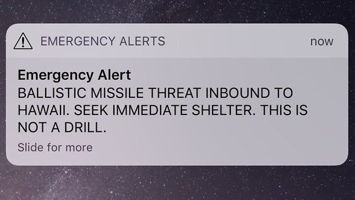 Phone screen capture of an alert message. 'Emergency alert: BALLISTIC MISSILE THREAT INBOUND TO HAWAII. SEEK IMMEDIATE SHELTER. THIS IS NOT A DRILL'